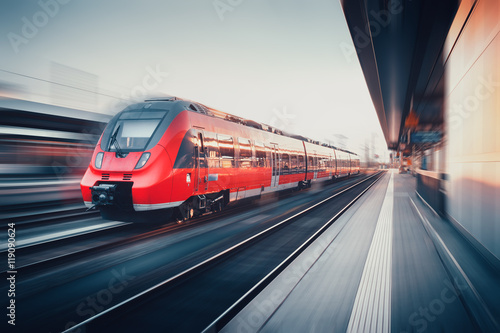 Beautiful railway station with modern red commuter train in moti