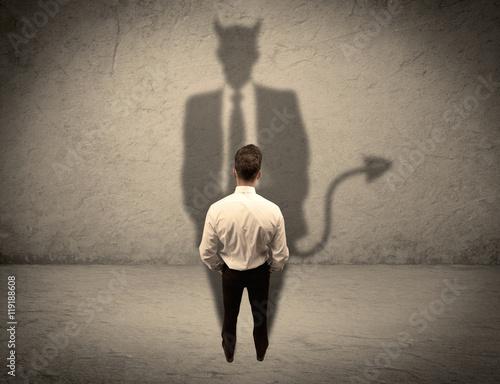 Tableau sur Toile Salesman facing his own devil shadow