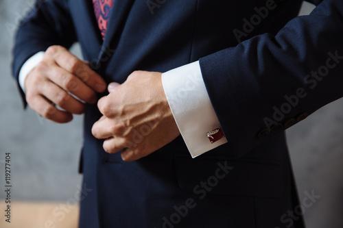 Obraz na płótnie Businessman hands with cufflinks. Elegant gentleman clother