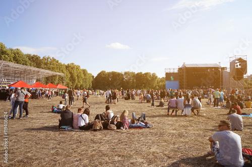 Obraz na plátně People at open air concert on sunny day