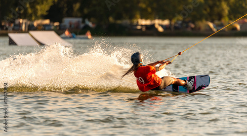 Young active woman on the wakeboard in cable park Merkur, Nove Mlyny, South Moravia, Czech Republic