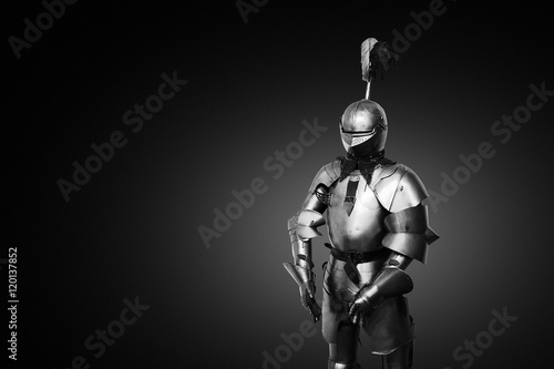 Canvas Print Old metal knight armour on black background
