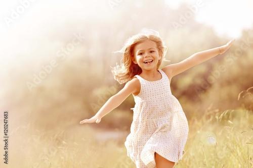 Fotografia, Obraz Little girl running in country field in summer