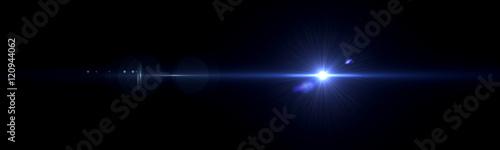 Fotografia Beautiful light flares. Glowing streaks on dark background