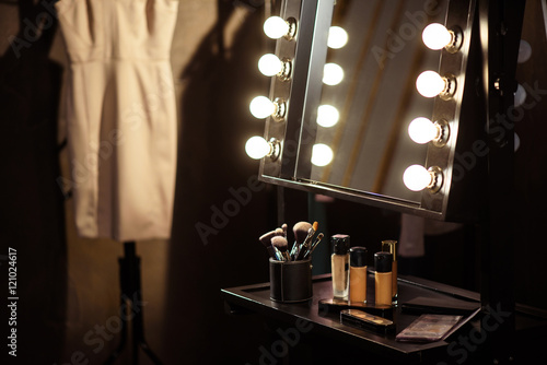 Fotografering Make-up products and dress backstage
