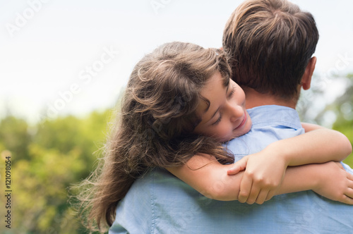 Daughter embracing father