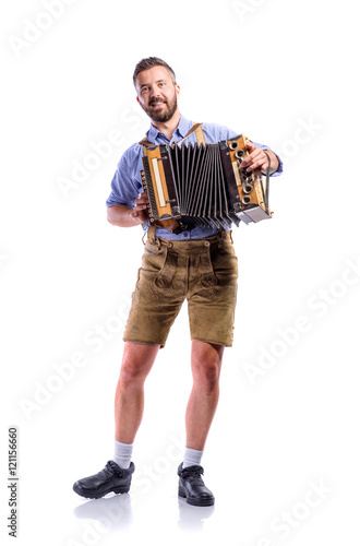 Photo Man in traditional bavarian clothes playing accordion. Oktoberfe