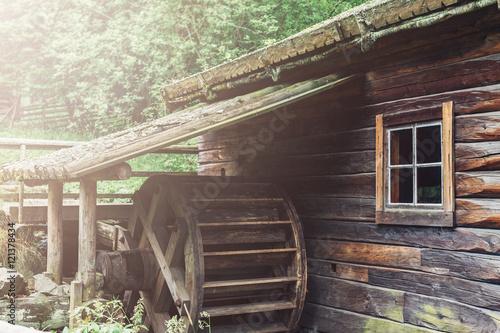 Old wooden waterwheel watermill