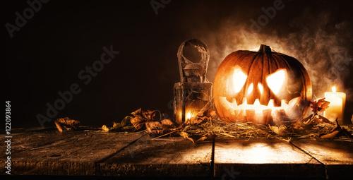 Fotografiet Scary halloween pumpkin on wooden planks