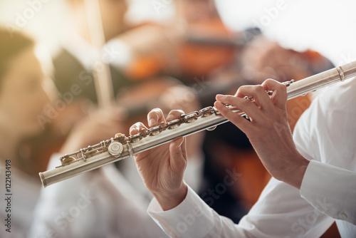 Professional flute player performing Fototapeta
