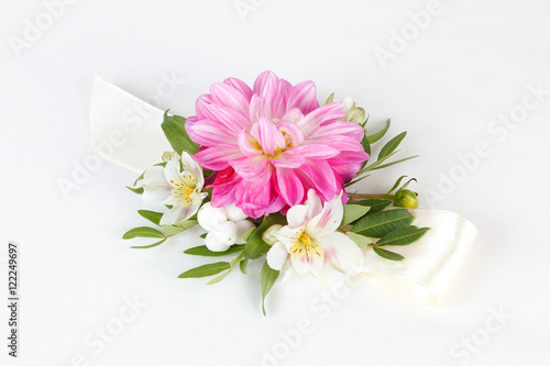 Tableau sur Toile Pink wrist corsage isolated on white background