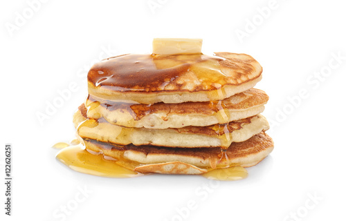 Tasty pancakes with honey and butter, isolated on white