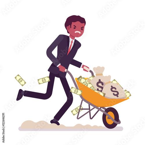 Fotografia Businessman pushing a wheelbarrow full of money