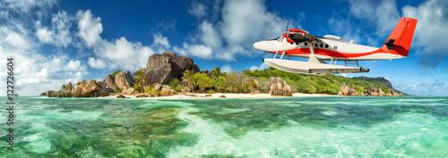 Stampa su Tela Seaplane with Seychelles island