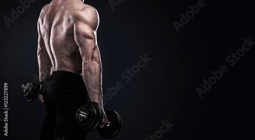 Bodybuilder doing exercises with dumbbells