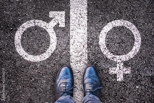 Canvas Print Legs with gender symbol on asphalt, gender concept
