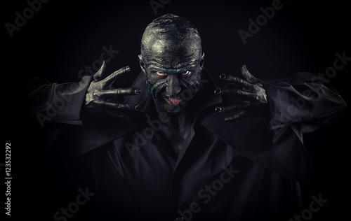 Wallpaper Mural Studio portrait of a man in monster makeup, dark background