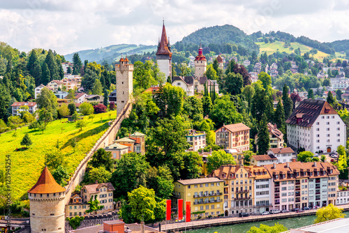 Fototapeta Top view on the old town with fortification wall and towers in Lucerne city in S