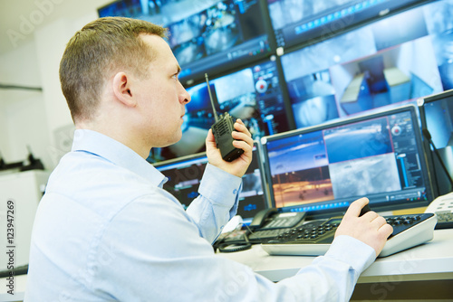 Fotografie, Obraz Surveillance security system. Video monitoring woker