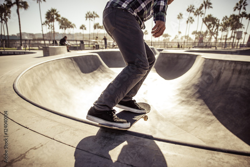 Wallpaper Mural Skater boy practicing at the skate park