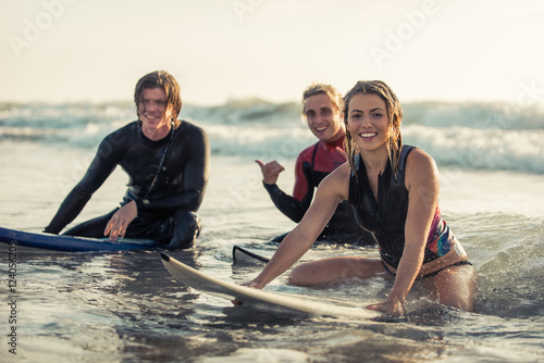 Group of surfers chilling out on the beach.