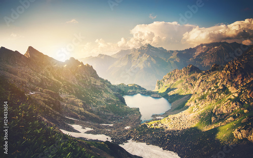 Beautiful Lake with Rocky Mountains Landscape Summer Travel scenic aerial view on sunset