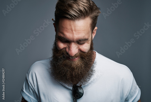 Stampa su Tela Giggling young man with large fuzzy beard