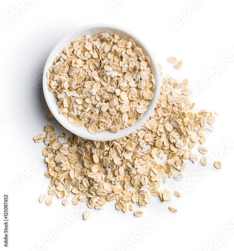 Dry rolled oatmeal in bowl.