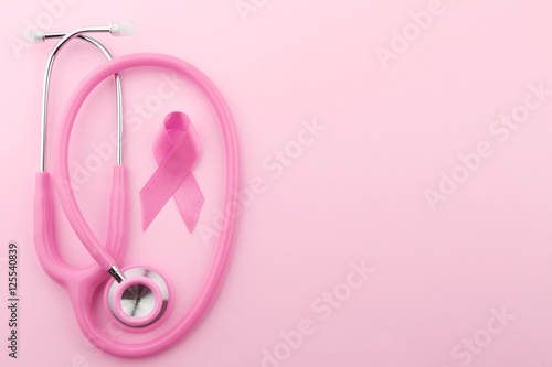 Canvas Print Stethoscope with pink ribbon on color background