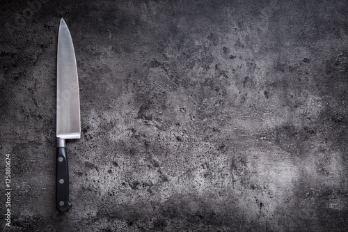 Fotografie, Obraz Kitchen knife on concrete or wooden board.