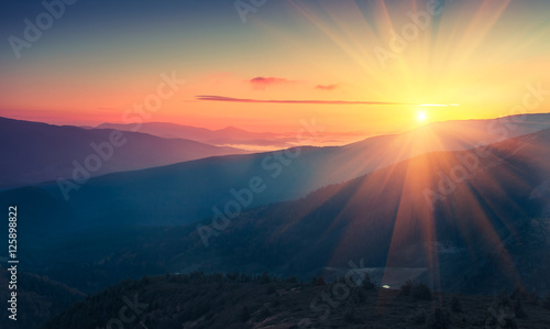 Obraz na plátne Panoramic view of  colorful sunrise in mountains