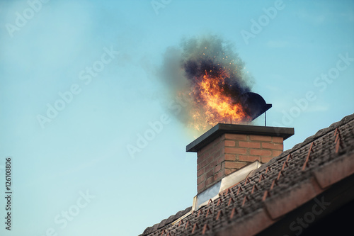 Fotografering Chimney with a fire coming out