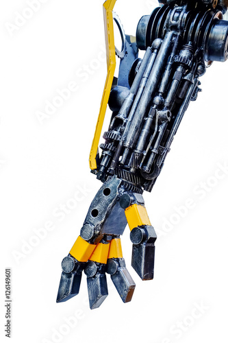 Photo Right arm of a robot made from car parts and spares