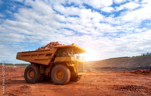 Photo big yellow mining truck at work site