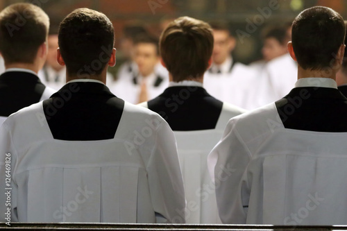 The young clerics of the seminary during Mass Fototapeta