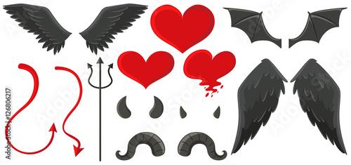Valokuva Angel wings and devil horns