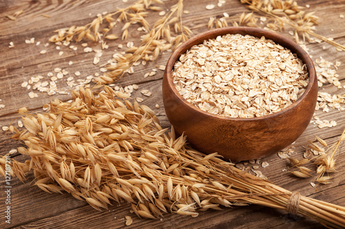 oat flakes in a bowl on the old board.