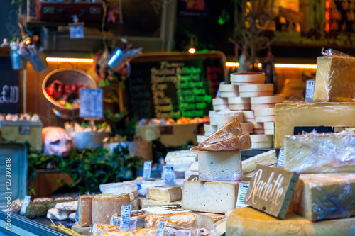 Fotografia, Obraz Variety of cheese on display in Borough Market, London