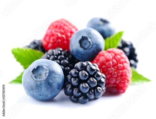 Fototapeta Sweet berries mix isolated on white background.