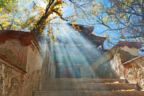 Small Buddhist temple on island in Park in Lhasa. Fototapeta