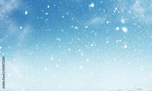 Obraz na plátně Winter christmas sky with falling snow