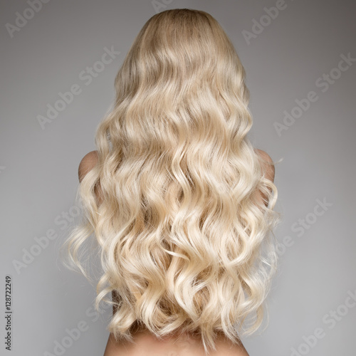 Portrait Of A Beautiful Young Blond Woman With Long Wavy Hair. Fototapete