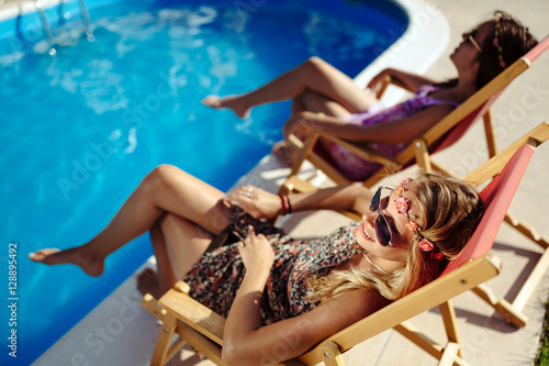 Tableau sur Toile Women relaxing and sunbathing in summer