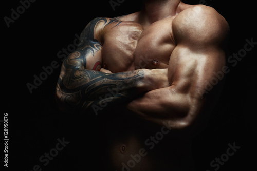 Wallpaper Mural Strong athletic man showes naked muscular body