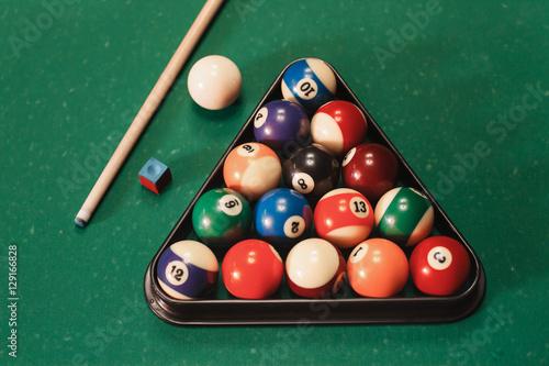 Fototapeta Billiard balls near by cue and chalk.