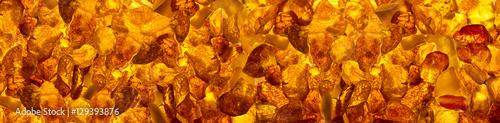Canvas-taulu panoramic closeup baltic amber stones rectangular lie on a flat surface