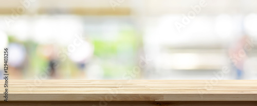 Fotografia Wood table top on blur kitchen window background, panoramic banner