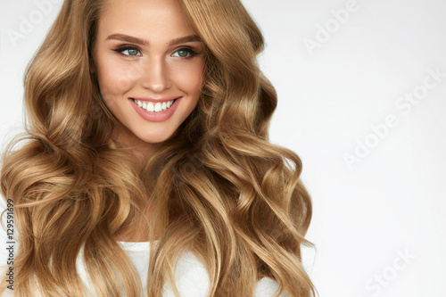 Beautiful Curly Hair. Girl With Wavy Long Hair Portrait. Volume