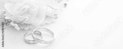 Valokuva Wedding rings on wedding card on a white background, border design panoramic ban