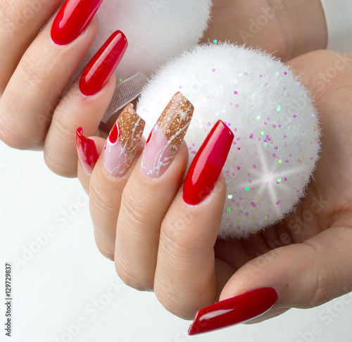 Photo red nails decorated for your fantastic Christmas